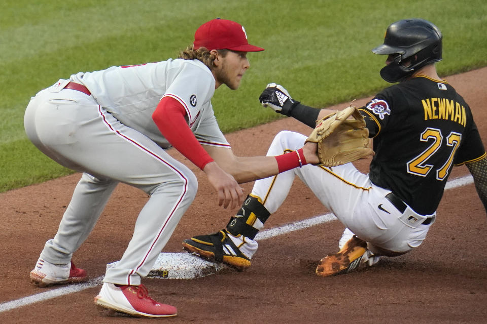 Pittsburgh Pirates' Kevin Newman (27) slides safely into third with an RBI triple, as Philadelphia Phillies third baseman Alec Bohm waits for the late relay throw during the third inning of a baseball game in Pittsburgh, Saturday, July 31, 2021. (AP Photo/Gene J. Puskar)