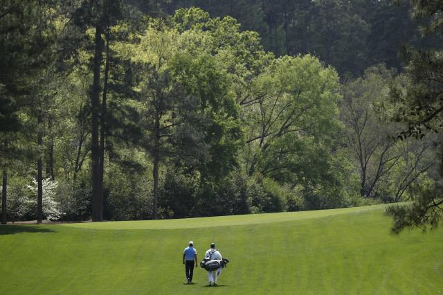 Rickie Fowler of the U.S. walks up the 11th fairway with his caddie during the second day of practice for the 2018 Masters golf tournament at Augusta National Golf Club in Augusta, Georgia, U.S. April 3, 2018. REUTERS/Mike Segar