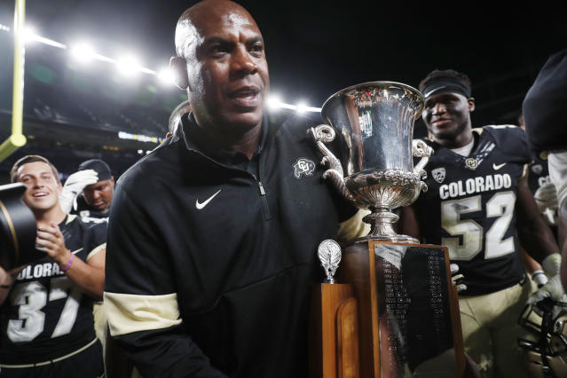 Colorado head coach Mel Tucker carries the Centennial Cup after his team defeated intrastate rival Colorado State in an NCAA college football game Friday, Aug. 30, 2019, in Denver. Colorado won 52-31. (AP Photo/David Zalubowski)
