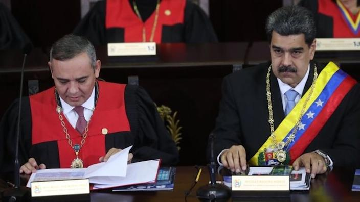 There is also a reward for information leading to the arrest of President Maduro (right)