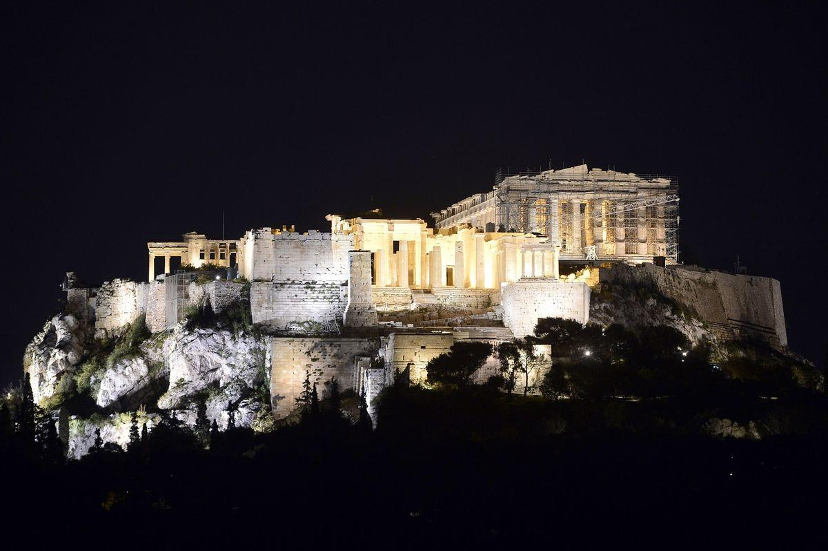 The ancient Acropolis in seen with lights on shortly before the lights were turned off during the Earth Hour in Athens on March 25, 2017. Earth Hour is a global call to turn off lights for one hour in a bid to highlight the global climate change. / AFP PHOTO / LOUISA GOULIAMAKI (Photo credit should read LOUISA GOULIAMAKI/AFP/Getty Images)