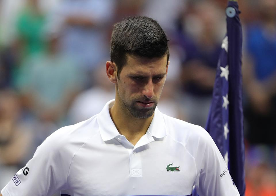 Serbia's Novak Djokovic waits for the trophy ceremony after losing to Russia's Daniil Medvedev during their 2021 US Open Tennis tournament men's final match at the USTA Billie Jean King National Tennis Center in New York, on September 12, 2021. (Photo by Kena Betancur / AFP) (Photo by KENA BETANCUR/AFP via Getty Images)