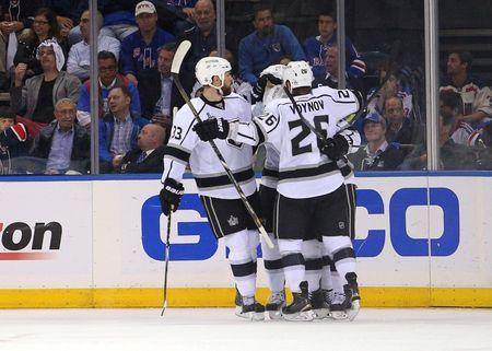 Jun 9, 2014; New York, NY, USA; Los Angeles Kings center Mike Richards (10) celebrates with teammates after scoring a goal against the New York Rangers during the second period in game three of the 2014 Stanley Cup Final at Madison Square Garden. Mandatory Credit: Brad Penner-USA TODAY Sports