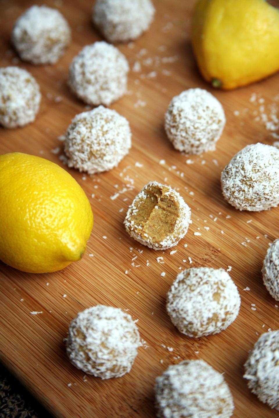 """<p>These lemon coconut protein balls are made with just five ingredients: raw almonds, vanilla protein powder, juicy dates, lemon juice, and unsweetened coconut.</p> <p><strong>Get the recipe:</strong> <a href=""""https://www.popsugar.com/fitness/Lemon-Coconut-Protein-Balls-41160578"""" class=""""link rapid-noclick-resp"""" rel=""""nofollow noopener"""" target=""""_blank"""" data-ylk=""""slk:lemon coconut protein balls"""">lemon coconut protein balls</a></p>"""
