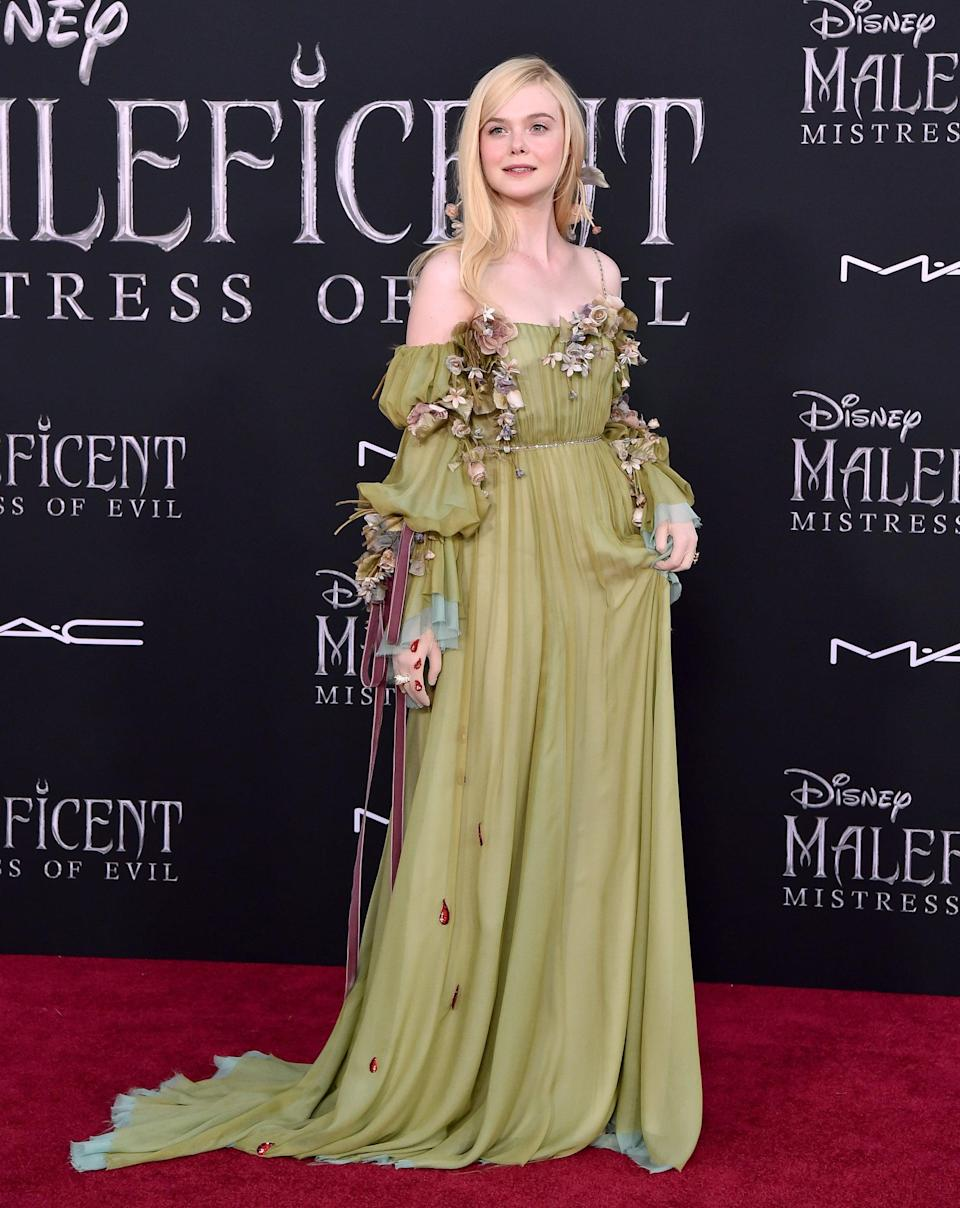 """<p>From the eye-catching <a href=""""https://www.popsugar.com/fashion/elle-fanning-gucci-outfit-sag-awards-2021-48252641"""" class=""""link rapid-noclick-resp"""" rel=""""nofollow noopener"""" target=""""_blank"""" data-ylk=""""slk:Gucci set"""">Gucci set</a> she wore to this year's SAG Awards to the stunning Vivienne Westwood <a href=""""https://www.popsugar.com/fashion/elle-fanning-purple-corset-dress-independent-spirit-awards-48286549"""" class=""""link rapid-noclick-resp"""" rel=""""nofollow noopener"""" target=""""_blank"""" data-ylk=""""slk:purple corset dress"""">purple corset dress</a> seen at the 2021 Independent Spirit Awards, Elle Fanning knows how to dress in a show-stopping way.</p>"""
