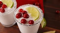 """<p>Just because its cold out doesn't mean we can't enjoy tequila! The cranberry garnish is so festive it makes making a whole batch worth it!</p><p>Get the recipe from <a href=""""https://www.delish.com/cooking/recipe-ideas/recipes/a57117/white-christmas-margaritas-recipe/"""" rel=""""nofollow noopener"""" target=""""_blank"""" data-ylk=""""slk:Delish"""" class=""""link rapid-noclick-resp"""">Delish</a>.</p>"""
