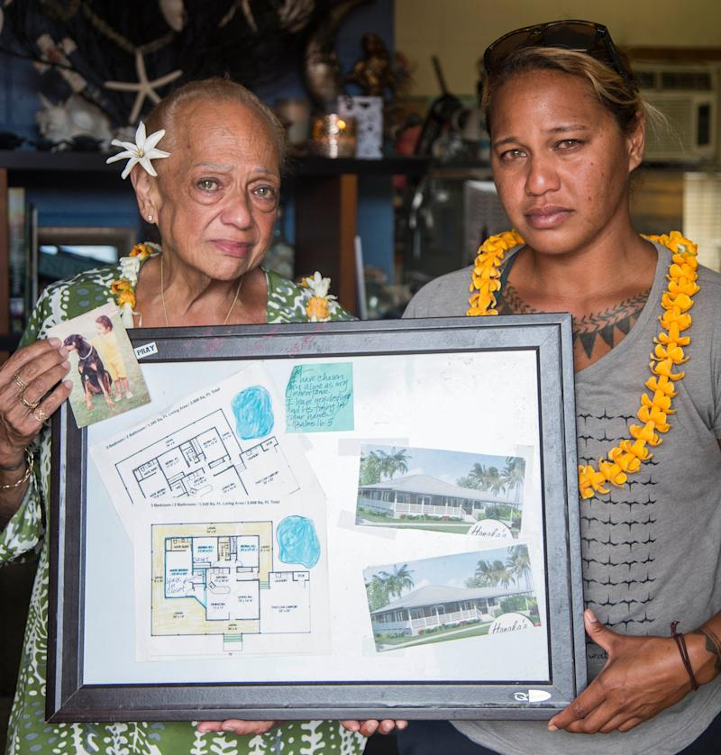 Joddy ʻIwalani Manuwai and her daughter Kaʻiulani Manuwai hold the blueprints for what their home was supposed to look like after renovations. (Photo: MARIE ERIEL HOBRO )