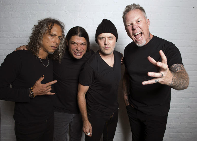 """In this Sept. 22, 2016 photo, Metallica band members, from left, Kirk Hammett, Robert Trujillo, Lars Ulrich and James Hetfield pose for a portrait in New York to promote their first album in eight years, """"Hardwired… To Self-Destruct."""" (Photo by Charles Sykes/Invision/AP)"""