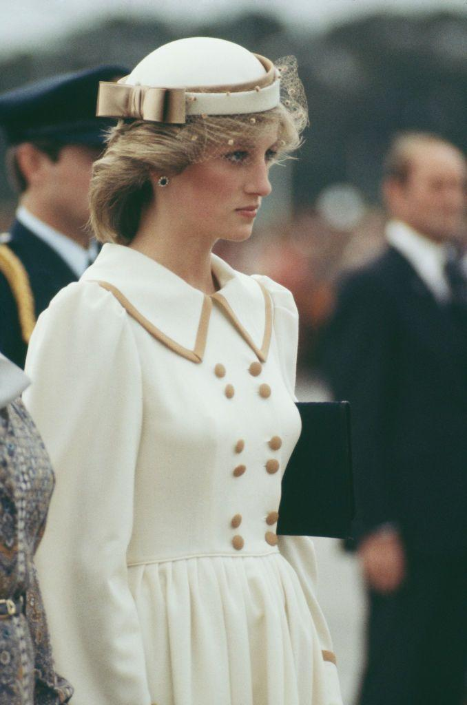 <p>Princess Diana arrived in Auckland, New Zealand for a royal tour in April of 1983, wearing an outfit by Catherine Walker with a hat by John Boyd.</p>
