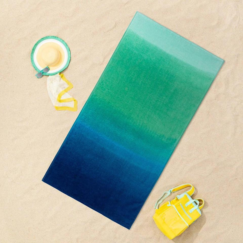 <p>Be one with the ocean with this gorgeous gradient <span>Sun Squad Printed Ombre Beach Towel Blue/Green</span> ($10).</p>
