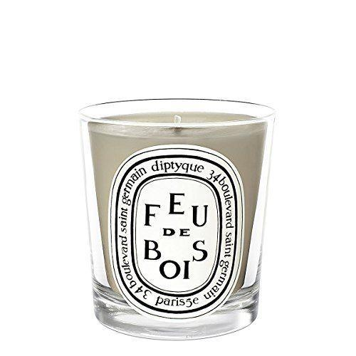 """<p><strong>Diptyque</strong></p><p>amazon.com</p><p><strong>$49.95</strong></p><p><a href=""""http://www.amazon.com/dp/B009AKHSRO/?tag=syn-yahoo-20&ascsubtag=%5Bartid%7C10050.g.2655%5Bsrc%7Cyahoo-us"""" rel=""""nofollow noopener"""" target=""""_blank"""" data-ylk=""""slk:Shop Now"""" class=""""link rapid-noclick-resp"""">Shop Now</a></p><p>This scent will recall nights spent making <a href=""""https://www.countryliving.com/food-drinks/g2006/smores-dessert-recipes/"""" rel=""""nofollow noopener"""" target=""""_blank"""" data-ylk=""""slk:s'mores by the campfire"""" class=""""link rapid-noclick-resp"""">s'mores by the campfire</a>. (And Diptyque containers are so beautiful, you'll want to keep them around long after the wax from the candle's melted down.)</p>"""
