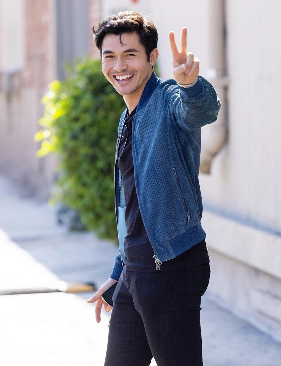 <p>Henry Golding is in great spirits outside of <em>Jimmy Kimmel Live!</em> on July 20 in L.A.</p>