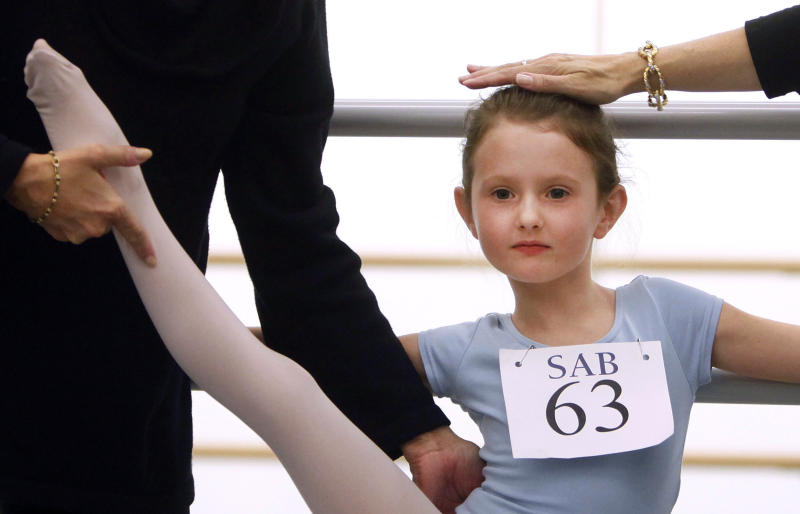 Natacha Ross, 6, of New York, is evaluated during an audition for six-year old ballet hopefuls at the School of American Ballet, Friday, April 5, 2013 in New York. (AP Photo/Jason DeCrow)
