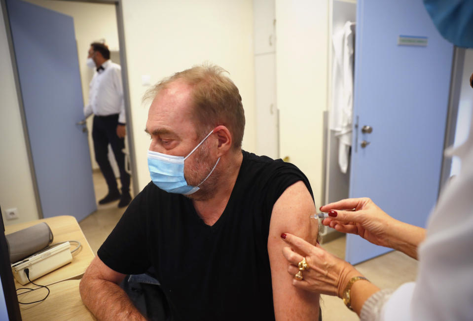 A man receives a Chinese made Sinopharm COVID-19 vaccine in Budapest, Hungary on Wednesday, Feb. 24, 2021. China is providing the vaccine to countries such as Serbia and Hungary -- a significant geopolitical victory in Central Europe and the Balkans, where the West, China and Russia are competing for political and economic influence. (AP Photo/Laszlo Balogh)