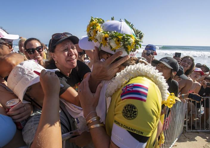 Carissa Moore gets a hug and lei from her mother, Carol Lum, after winning her fifth WSL title