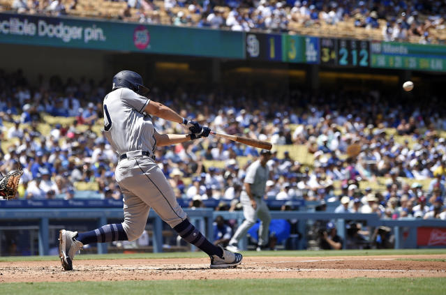 San Diego Padres' Eric Hosmer hits a grand slam during the third inning of a baseball game against the Los Angeles Dodgers. Sunday, Aug. 4, 2019, in Los Angeles. (AP Photo/Mark J. Terrill)