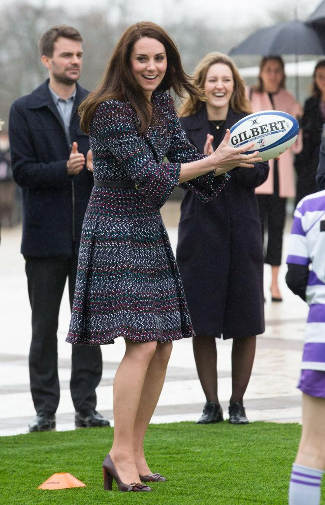Kate Middleton plays rugby with French fans at Trocadero square.