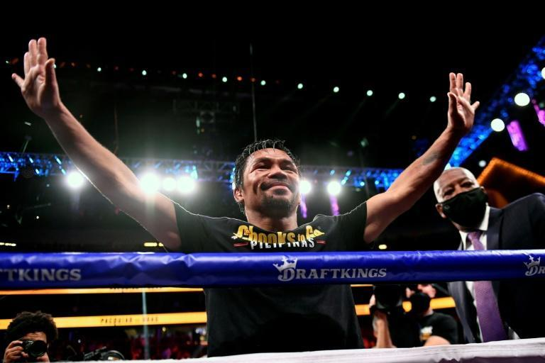 Manny Pacquiao lost his last fight against Yordenis Ugas of Cuba but retires as one of the greatest boxers of all time (AFP/Patrick T. FALLON)