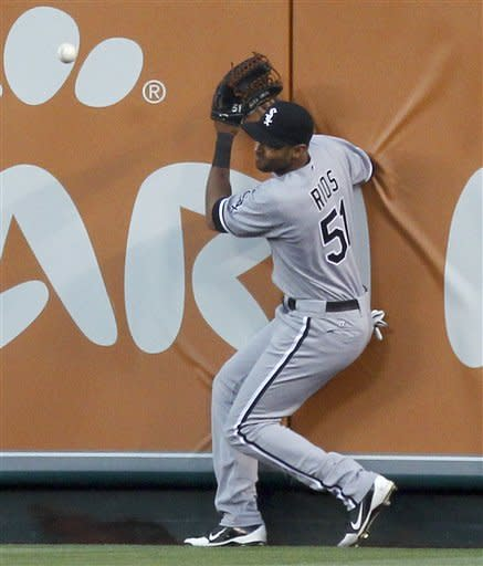 Chicago White Sox right fielder Alex Rios can't get a glove on an RBI double by Los Angeles Angels' Erick Aybar during the second inning of a baseball game in Anaheim, Calif., Wednesday, May 16, 2012. (AP Photo/Chris Carlson)