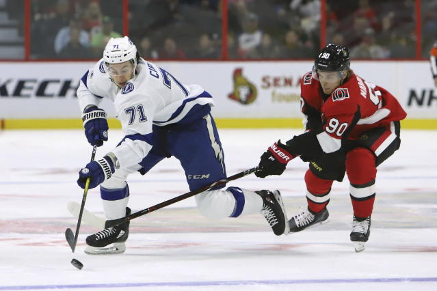 Ottawa Senators centre Vladislav Namestnikov (90) attempts to check Tampa Bay Lightning centre Anthony Cirelli (71) during first period of NHL hockey action in Ottawa, Saturday, Oct. 12, 2019. (Fred Chartrand/The Canadian Press via AP)