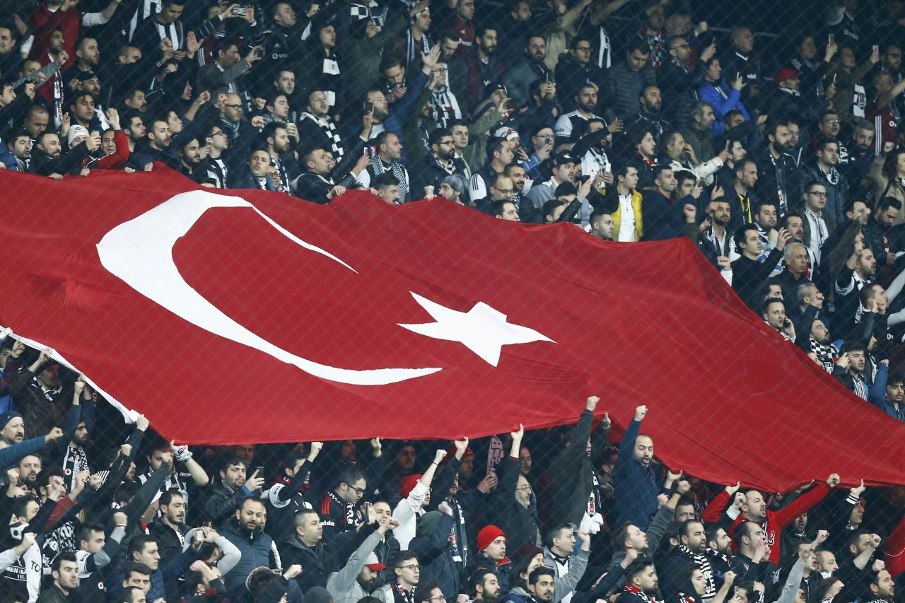 Football Soccer- Besiktas v Olympiacos - UEFA Europa League Round of 16 Second Leg - Vodafone Arena, Istanbul, Turkey - 16/3/17 Fans of Besiktas wave a Turkish national flag during their match against Olympiacos. REUTERS/Osman Orsal