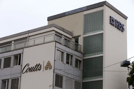 The logos of Royal Bank of Scotland and of bank Coutts are seen at an office building in Zurich