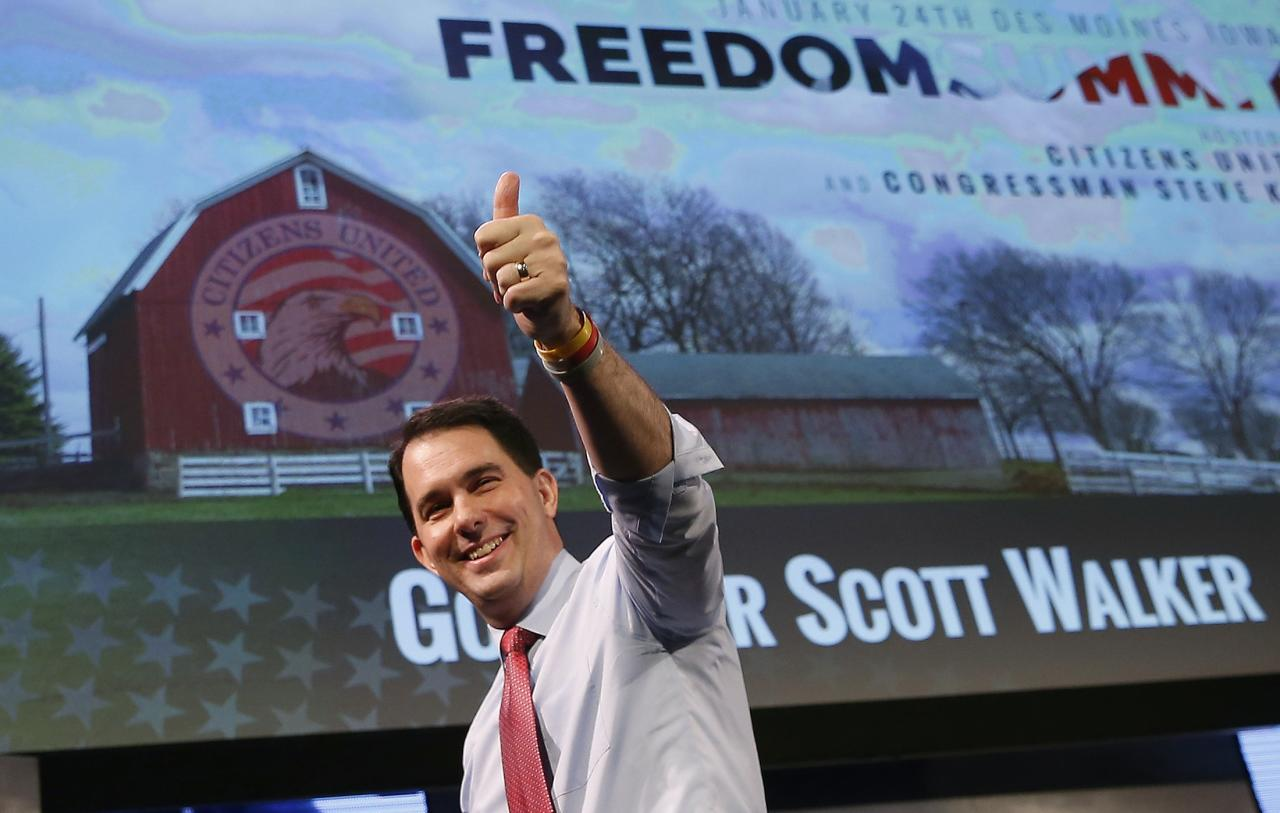 Wisconsin Governor Scott Walker walks off the stage after speaking at the Freedom Summit in Des Moines, Iowa, in this file photo January 24, 2015.  Walker had a breakthrough moment at a forum for conservatives in Iowa and on Tuesday took a step toward a U.S. presidential run. REUTERS/Jim Young/Files   (UNITED STATES - Tags: POLITICS)