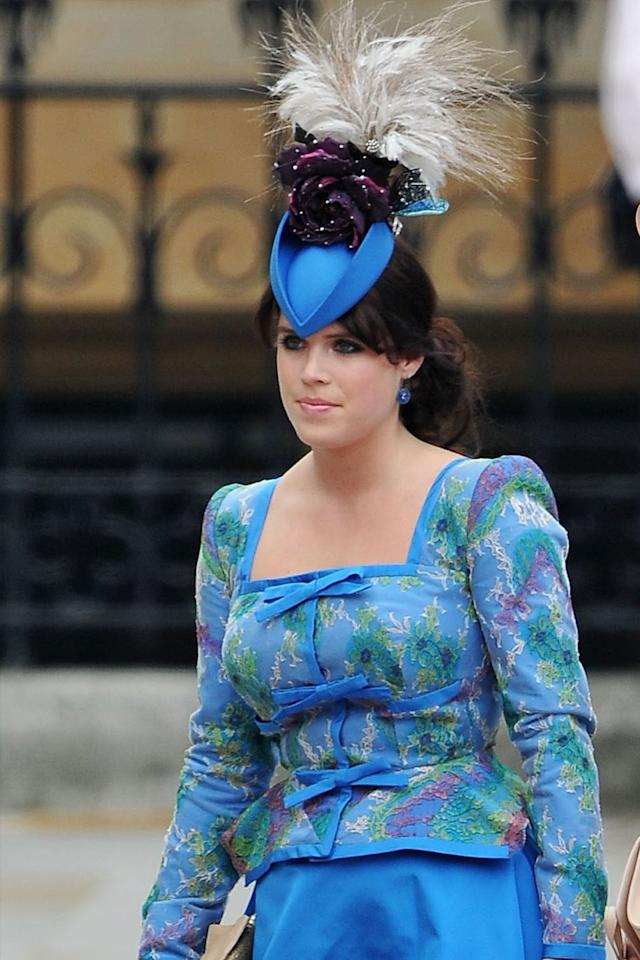 <p>As for Beatrice's sister, Eugenie, she too went all out with an electric blue hat featuring dark purple flowers and feathers. Her headpiece complimented the floral Vivienne Westwood suit  she picked out for the occasion.</p>