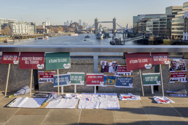 A memorial organised by the multi-faith charity 'Faiths Forum', appeared on the bridge showing the faces of victims and their friends.