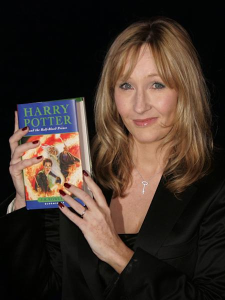 FILE -- In this Friday, July 15, 2005 file photo shows British author J.K. Rowling holding a copy of her latest book 'Harry Potter and the Half-Blood Prince' as she arrives at Edinburgh Castle in Edinburgh, Scotland, for its world wide launch. At last, Harry Potter's adventures are available electronically. The seven novels about J.K. Rowling's boy wizard are for sale as e-books and audio books on the author's Pottermore website, the site's creators announced Tuesday March 27, 2012. The books are available only through the website, which says they are compatible with major electronic e-readers, including Amazon's Kindle and Sony's Reader, as well as with tablets and mobile phones. (AP Photo/Matt Dunham, File)