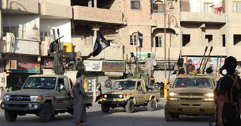 An image made available by Jihadist media outlet Welayat Raqa allegedly shows members of the Islamic State militant group parading in a street in the northern rebel-held Syrian city of Raqa on June 30, 2014