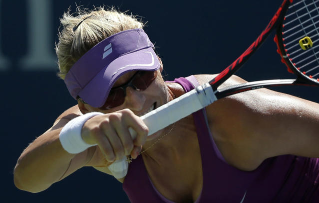 Mirjana Lucic-Baroni, of Croatia, returns a shot against Simona Halep, of Romania, during the third round of the 2014 U.S. Open tennis tournament, Friday, Aug. 29, 2014, in New York. (AP Photo/Elise Amendola)