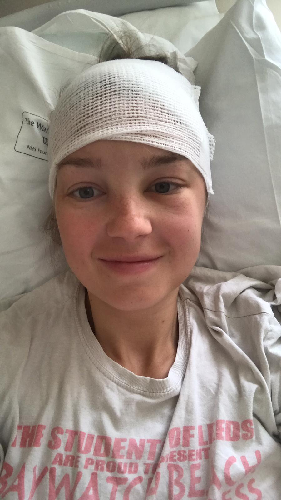 Emma Bond with a bandage around her head following surgery.