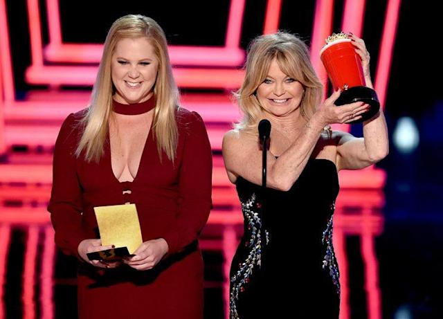 Amy Schumer and Goldie Hawn poked fun at the Oscars' Best Picture gaffe while presenting at the 2017 MTV Movie & TV Awards. (Photo: Kevin Winter/Getty Images)