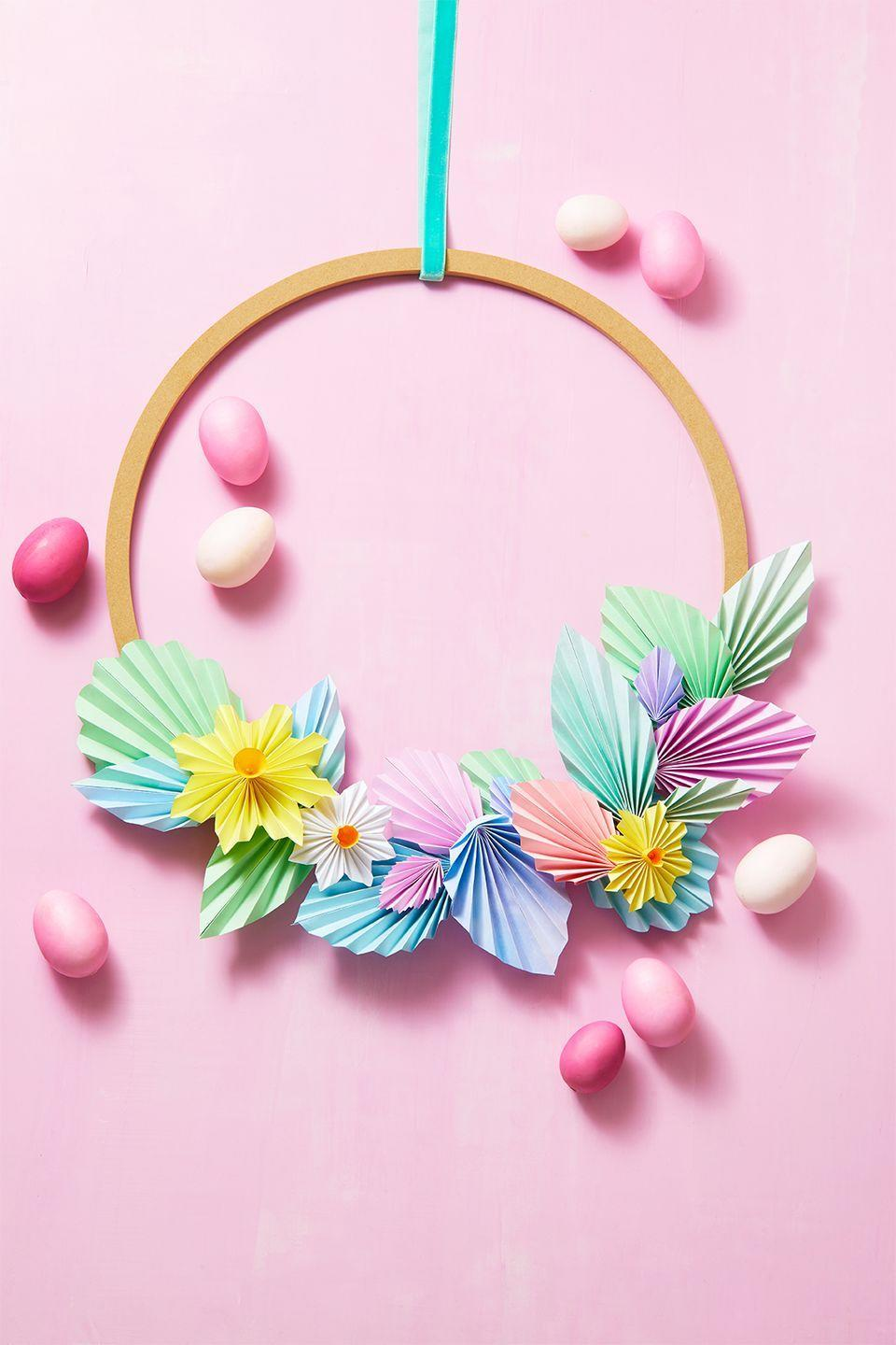 """<p>Embrace the beauty of the spring with a wreath that puts eye-catching pastel colors on full display. For this look, a wooden frame is taken to the next level with an assortment of vibrant paper leaves and flowers. </p><p><a href=""""https://www.goodhousekeeping.com/holidays/easter-ideas/g977/spring-easter-wreaths/?slide=1"""" rel=""""nofollow noopener"""" target=""""_blank"""" data-ylk=""""slk:Get the tutorial »"""" class=""""link rapid-noclick-resp""""><em>Get the tutorial »</em></a></p>"""