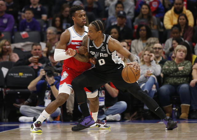 Sacramento Kings guard Buddy Hield, left, tries to stop the drive of San Antonio Spurs forward DeMar DeRozan during the first quarter of an NBA basketball game in Sacramento, Calif., Saturday, Feb. 8, 2020. (AP Photo/Rich Pedroncelli)