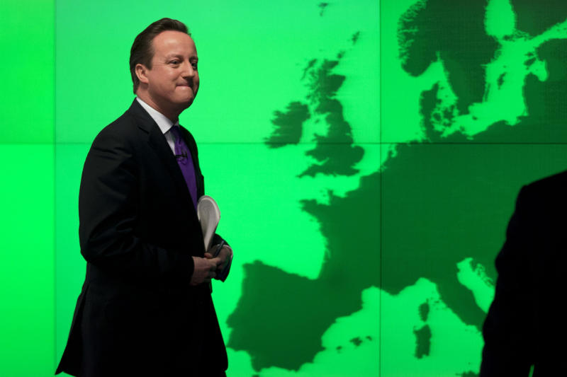 "Britain's Prime Minister David Cameron walks past a map of Europe on a screen as he walks away after making a speech on holding a referendum on staying in the European Union in London, Wednesday, Jan. 23, 2013. Cameron said Wednesday he will offer British citizens a vote on whether to leave the European Union if his party wins the next election, a move which could trigger alarm among fellow member states. He acknowledged that public disillusionment with the EU is ""at an all-time high,"" using a long-awaited speech in central London to say that the terms of Britain's membership in the bloc should be revised and the country's citizens should have a say. (AP Photo/Matt Dunham)"