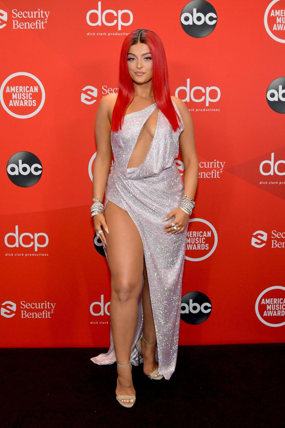 <p>Wearing a Julien Macdonald dress with Casadei shoes and Sydney Evan jewels.</p>