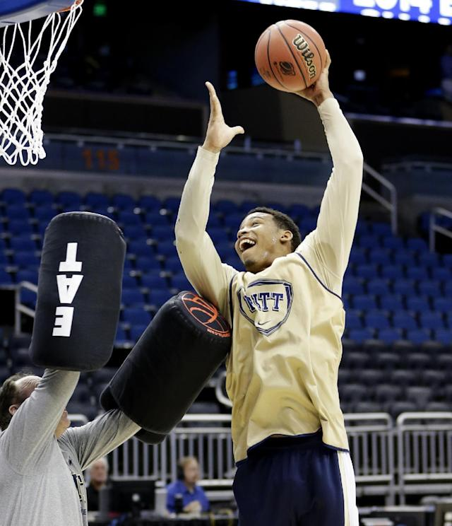 Pittsburgh's James Robinson shoots the ball during a drill at practice for the NCAA college basketball tournament in Orlando, Fla., Wednesday, March 19, 2014. Colorado plays against Pittsburgh in a second round game on Thursday. (AP Photo/John Raoux)