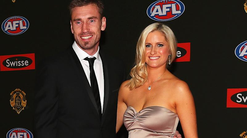 Shane Tuck and his wife Katherine are pictured posing on the read carpet before the 2012 Brownlow Medal count.