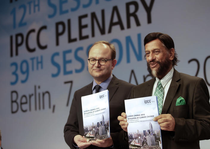Ottmar Edenhofer, Co-Chairman of the IPCC Working Group III, and Rejendra K. Pachauri, Chairman of the IPCC, from left, pose prior to a press conference as part of a meeting of the Intergovernmental Panel on Climate Change (IPCC) in Berlin, Germany, Sunday, April 13, 2014. The panel met from April 7, 2014 until April 12, 2014 in the German capital. (AP Photo/Michael Sohn)