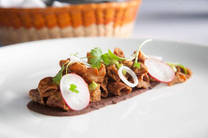 "<p>About an hour outside of Mexico City, chef Pablo Salas is implementing forward-thinking techniques and practices at his raved-about <a rel=""nofollow"" href=""http://www.thedailymeal.com/amaranta-cocina-mexiquense-contemporanea-pablo-salas""><strong>Amaranta</strong></a>. There, Salas uses modern cooking styles to enhance local produce and deliver dishes with big, bold flavors. For appetizers, go for the <a rel=""nofollow"" href=""http://www.thedailymeal.com/travel/12-deceptively-delicious-dishes-around-world-0/slide-12""><strong>pig trotters</strong></a> carpaccio au vinegar — fine slices of boneless pig's feet with vinegar, olive oil, and oregano, with cabbage salad, <a rel=""nofollow"" href=""http://www.thedailymeal.com/best-recipes/chayote""><strong>chayote</strong></a>, carrots, and serrano chiles. Mains include <a rel=""nofollow"" href=""http://www.thedailymeal.com/best-recipes/oxtail""><strong>oxtail</strong></a> in a manzano pepper mole served with a salt-cured nopal (cactus) salad and cilantro sprouts; <a rel=""nofollow"" href=""http://www.thedailymeal.com/best-recipes/roast-veal""><strong>roasted veal breast</strong></a> braised for six hours and served with refried beans, pico de gallo, and guacamole-tomatillo sauce; chicken with mole served with glazed sesame and vegetables; and ribeye served with smoked mashed potatoes, organic white beets, and truffle oil. Salas' brother, Francisco, is the sommelier here and creates unique food and drink pairings, making sure not to neglect local beers and spirits.</p>"