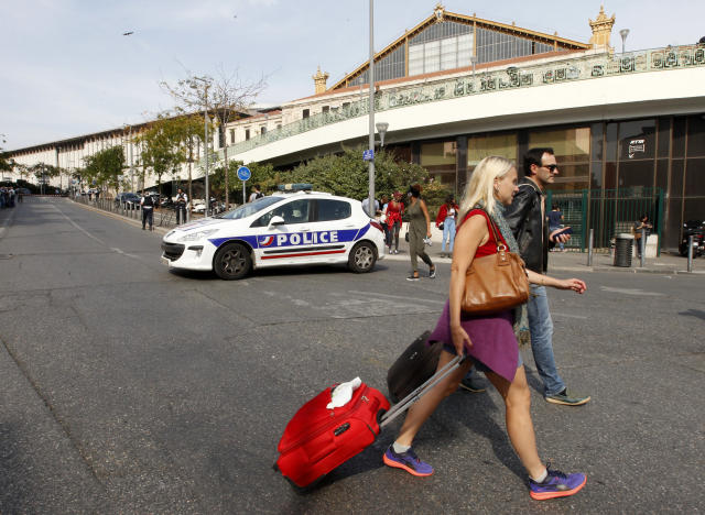 <p>Passengers leave Marseille 's main train station, Oct. 1, 2017 in Marseille, southern France. A man with a knife attacked people at the main train station in Marseille on Sunday, killing one person before soldiers shot dead the assailant, officials said. (AP Photo/Claude Paris) </p>