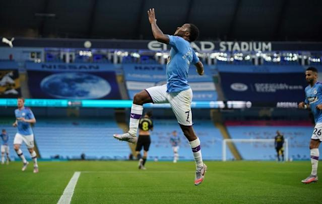 Raheem Sterling celebrates his first goal of 2020 in front of empty stands at the Etihad (AFP Photo/Dave Thompson)