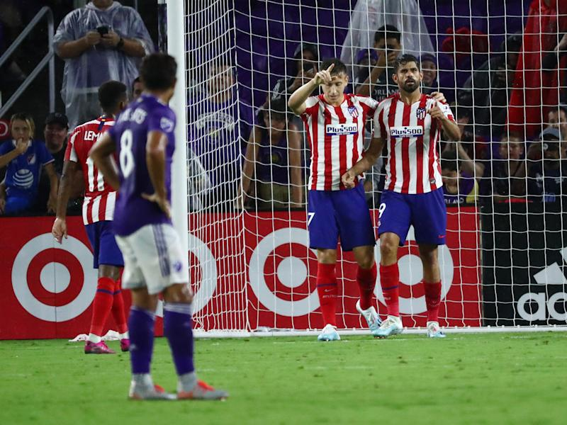 Jul 31, 2019; Orlando, FL, USA; Atletico Madrid forward Diego Costa (19) celebrates with Atletico Madrid forward Ivan Saponjic (17) after scoring a goal against the MLS All Star Team in the second half during the 2019 MLS All Star Game at Exploria Stadium. Mandatory Credit: Kim Klement-USA TODAY Sports