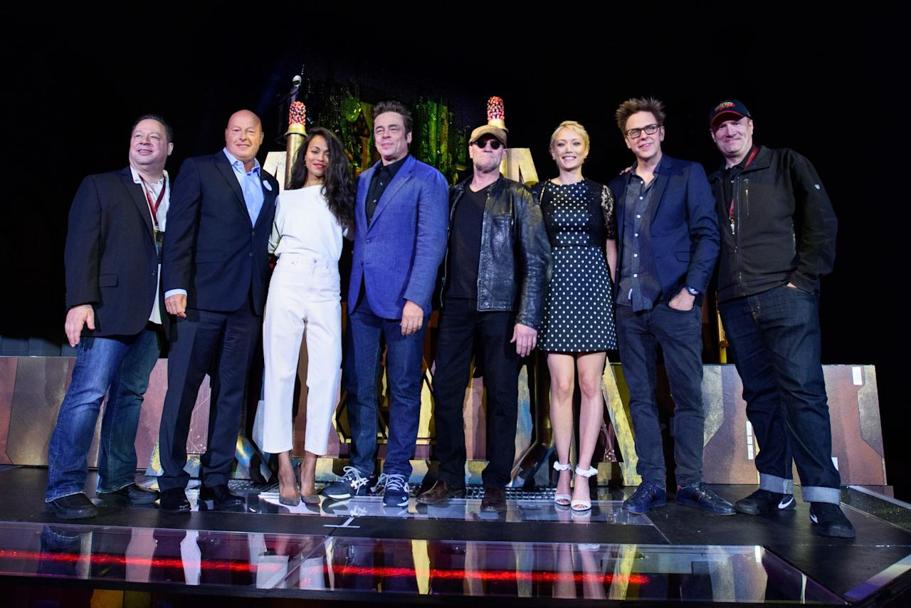 <p>Joe Quesada (chief creative officer of Marvel Entertainment), Bob Chapek (chairman of Walt Disney Parks and Resorts), Zoe Saldana (Gamora), Benicio Del Toro (The Collector), Michael Rooker (Yondu), Pom Klementieff (Mantis), James Gunn (<i>Guardians</i> writer-director), and Kevin Feige (president of Marvel Studios), at the May 25 gala opening of Guardians of the Galaxy <span>—</span> Mission: Breakout! attraction at Disney California Adventure park, in Anaheim, Calif. (Photo: Disneyland Resort) </p>