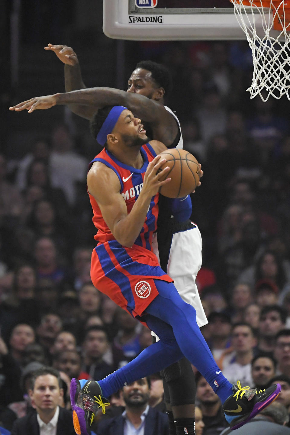 Detroit Pistons guard Bruce Brown, left, shoots as Los Angeles Clippers forward JaMychal Green defends during the first half of an NBA basketball game Thursday, Jan. 2, 2020, in Los Angeles. (AP Photo/Mark J. Terrill)
