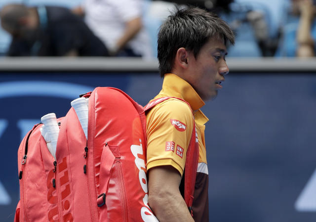Japan's Kei Nishikori leaves the court after Poland's Kamil Majchrzak retired injured in their first round match at the Australian Open tennis championships in Melbourne, Australia, Tuesday, Jan. 15, 2019. (AP Photo/Mark Schiefelbein)