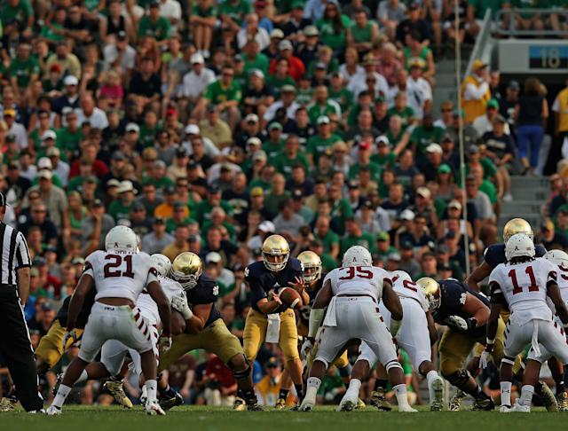 SOUTH BEND, IN - AUGUST 31: Tommy Rees #11 of the Notre Dame Fighting Irish takes the snap against the Temple Owls at Notre Dame Stadium on August 31, 2013 in South Bend, Indiana. Notre Dame defeated Temple 28-6. (Photo by Jonathan Daniel/Getty Images)