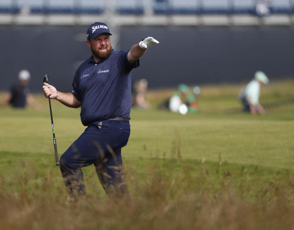 Ireland's Shane Lowry gestures after playing out of the rough on the 1st fairway the first round British Open Golf Championship at Royal St George's golf course Sandwich, England, Thursday, July 15, 2021. (AP Photo/Peter Morrison)